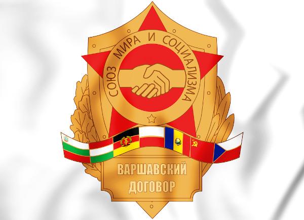 """Emblema do Pacto de Varsóvia com as bandeiras dos países integrantes. No círculo, lê-se: """"União da Paz e do Socialismo""""."""