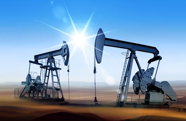 Imagem de dois equipamentos que perfuram o solo e extraem petróleo.